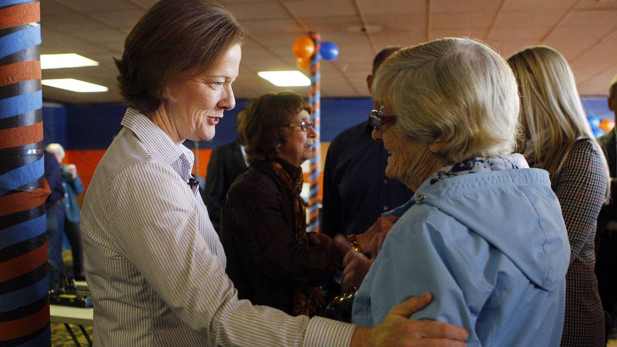 Alberta Premier and PC leader Alison Redford, left, greets an elderly supporter as she makes a campaign stop in Calgary, Alta., Saturday, March 31, 2012.