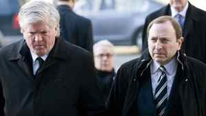 Toronto Maple Leafs general manager Brian Burke, left, and NHL commissioner Gary Bettman attend the funeral of former NHL coach Pat Burns in Montreal, Monday, November 29, 2010. THE CANADIAN PRESS/Graham Hughes