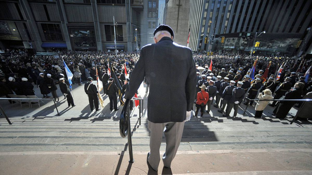 Robert Connery, an 87-year-old navy veteran who served in the Second World War, stands outside Toronto's Old City Hall during Remembrance Day ceremonies on Nov 11 2010.