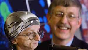 Dr. Francis Collins, right, author of a study suggesting the protein that causes accelerated aging in children also has a role in normal aging. He is seen with 15-year-old John Tacket in 2003.