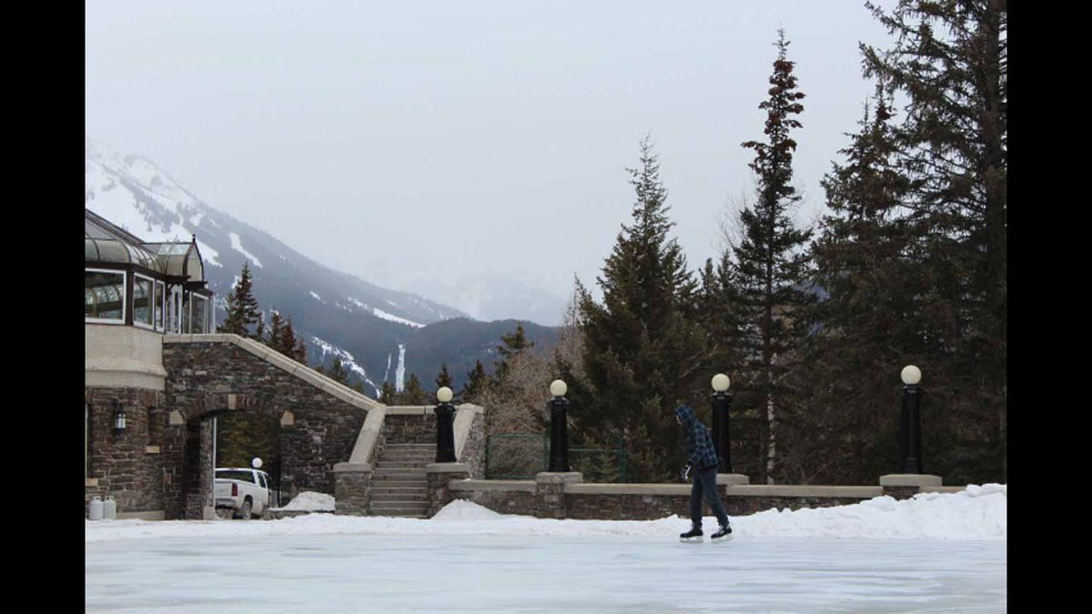 A man skating at the Banff Spring's Hotel - view on the ice