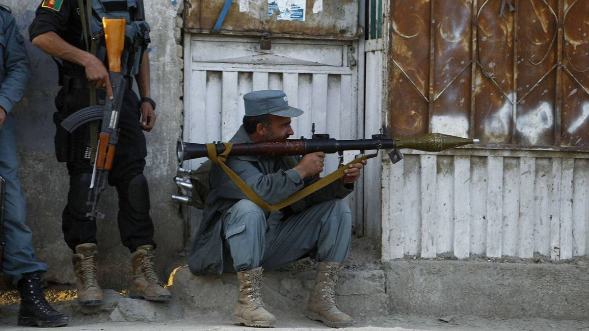 Afghan policemen take position at the site of the attack in Kabul April 15, 2012.