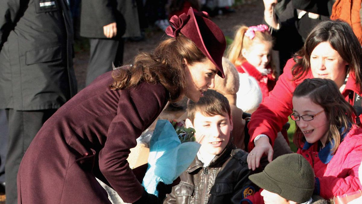 Catherine, Duchess of Cambridge accepts flowers from members of the crowd as she leaves Sandringham Church after the traditional Christmas Day service at Sandringham on December 25, 2011 in King's Lynn, England. The Queen and the Duke of Edinburgh traditionally lead the royals in attending a church service at Sandringham Church on Christmas Day. It is the Duchess of Cambridge's first Christmas at Sandringham after her marriage to Prince William, Duke of Cambridge in April of this year. This year the Duke of Edinburgh mised the service as he is in Papworth Hospital after having cardiac surgery to fit a stent in his coronary artery.