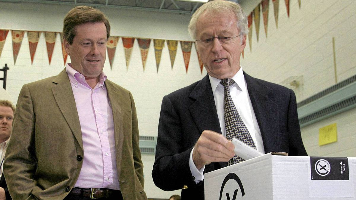 Former Ontario Progressive Conservative party leader John Tory, left, watched his father John Tory Sr. cast his ballot in the 2007 Ontario provincial election