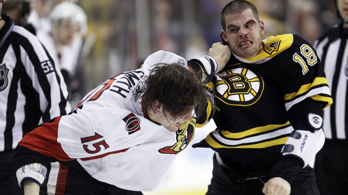Boston Bruins' Nathan Horton, right, fights with Ottawa Senators' Zack Smith during the second period of an NHL hockey game in Boston, Saturday, April 9, 2011. The Bruins won 3-1. (AP Photo/Charles Krupa)