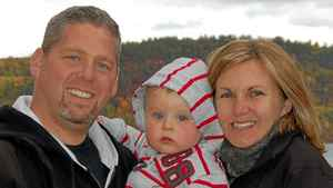 Sergeant Ryan Russell, his two-year-old son, Nolan, and his wife, Christine
