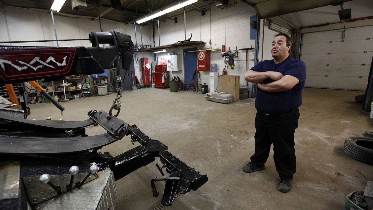 Frank Rondinelli, owner of Charterhouse Auto Body and Collision, at his shop in London on Feb. 9, 2012. He has seen a big drop in customers since Electro-Motive Diesel workers were locked out and Caterpillar announced it would shut down the plant.