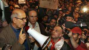 Opposition leader Mohamed ElBaradei waves to supporters in Tahrir Square on January 30, 2011 in Cairo, Egypt.