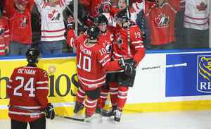 Brayden Schenn #10, Ryan Ellis #6, and Ryan Johansen #19 of Canada celebrate Ellis scoring Canada's first goal against Russia during the 2011 IIHF World U20 Championship Gold medal game between Canada and Russia at the HSBC Arena on January 5, 2011 in Buffalo, New York.