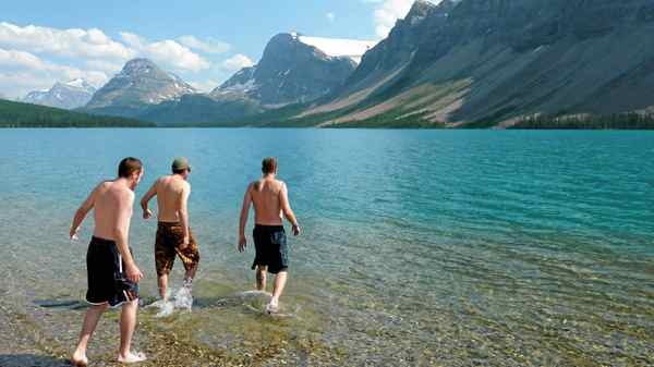 A mancation should have adventure and challenge, in this case, a swim in an ice-cold glacier lake at the Num-Ti-Jah Lodge on Bow Lake in the Rockies.