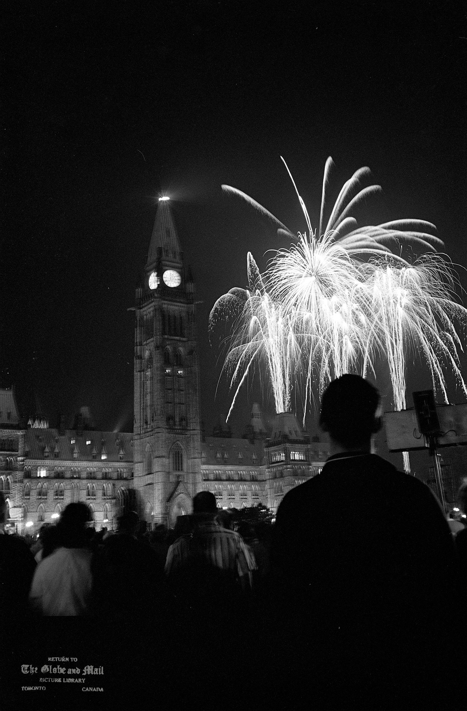 JULY 1, 1967 -- CANADA DAY CELEBRATIONS -- Fireworks display explodes above Parliament Buildings during celebration of Canada's Centennial of Confederation. Photo by John McNeill / The Globe and Mail (Scanned from Neg. 67181-4) COPYRIGHT VERIFIED. STAFF PHOTOGRAPHER. GLOBE AND MAIL CREDIT. CLEARED FOR ALL USES.