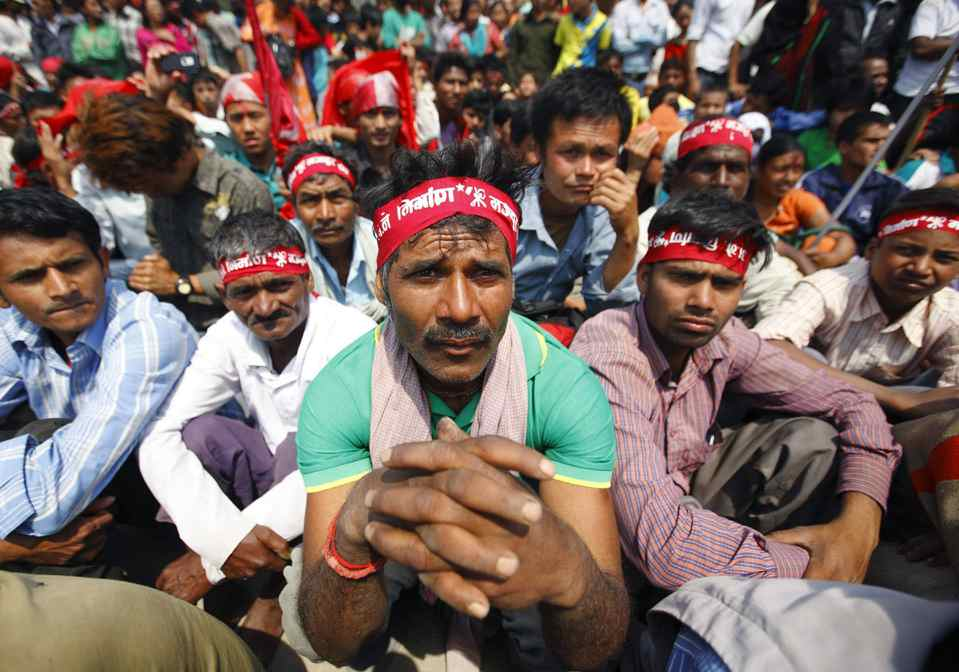 Maoist activists and supporters, wearing Maoist headbands, attend an event to commemorate Labour Day in Kathmandu.