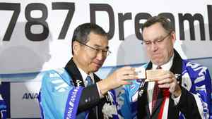 All Nippon Airways president Shinichiro Ito, left, and Boeing Co. vice-president Scott Fancher share a toast Wednesday, Oct. 26, before the airline's first special charter flight of the Boeing 787 Dreamliner at Narita airport in Tokyo. ANA is the first airline to fly the plane and expects to have seven of them by the end of the year.