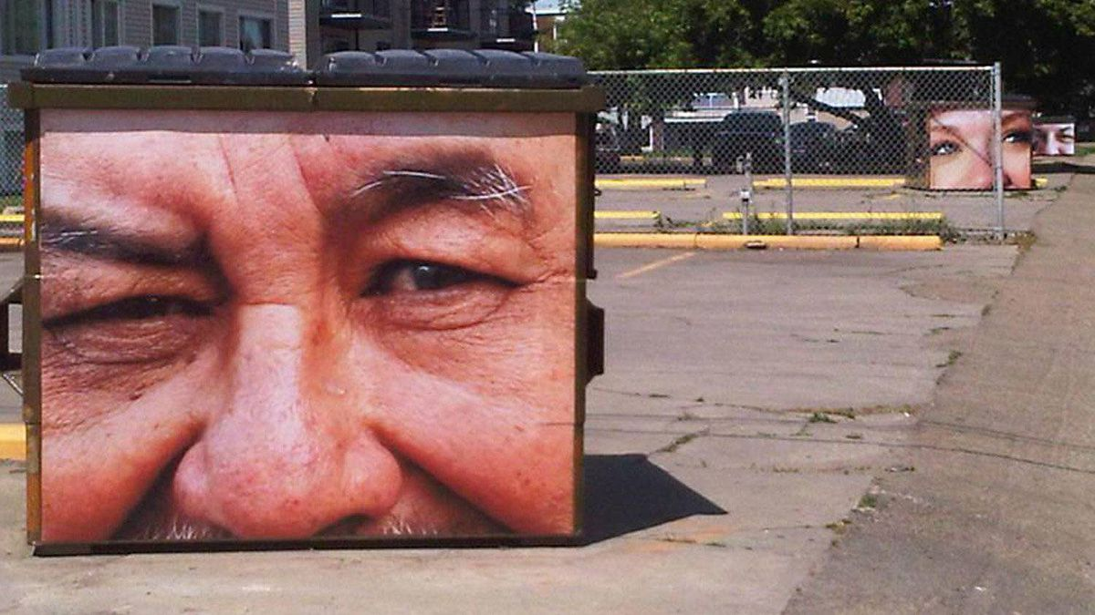 An art program through the police department in Edmonton publishes photographs taken by community members and police on dumpsters.