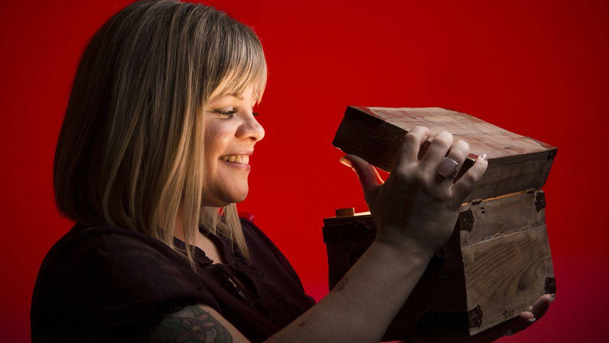 Calgary resident Trena Barnes looks inside her God Box.
