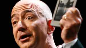 Jeff Bezos, chief executive officer of Amazon.com Inc., introduces the new Kindle Touch e-reader at a news conference in New York, U.S., on Wednesday, Sept. 28, 2011.