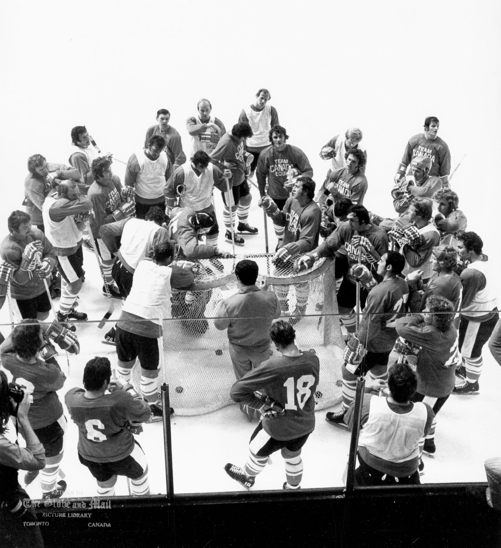 AUGUST 14, 1972 -- TORONTO -- TEAM CANADA TRAINING CAMP -- Team Canada players gather around net for discussion during first practice session at Maple Leaf Gardens in Toronto on August 14, 1972. Head coach Harry Sinden, centre, has his back to camera as he listens. Series against Russia starts Sept. 2, 1972 in Montreal. Photo by Barrie Davis / The Globe and Mail. Not published.