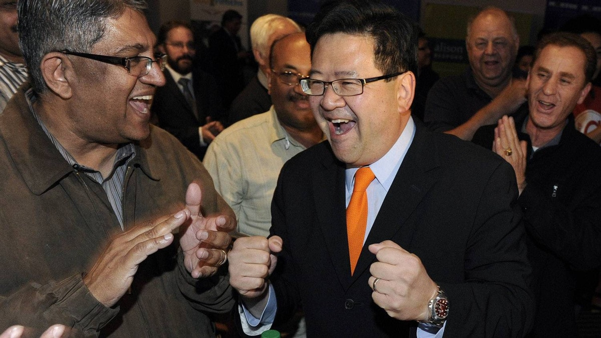Gary Mar (R) reacts to leading in the first ballots in the leadership race for the PC Party of Alberta in Calgary, September 17, 2011.