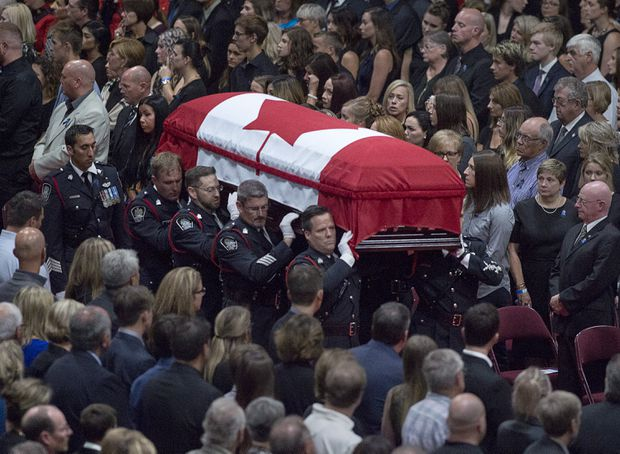 thousands attend funeral service for officers killed in fredericton