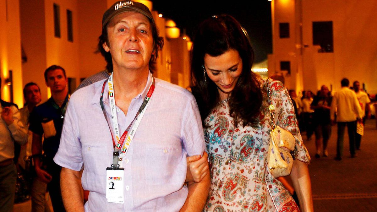 Musician Paul McCartney and his wife Nancy Shevell walk in the paddock following qualifying for the Abu Dhabi Formula One Grand Prix at the Yas Marina Circuit on November 12, 2011 in Abu Dhabi, United Arab Emirates.
