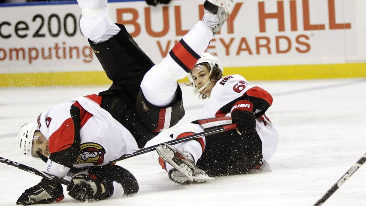 Ottawa Senators forward Milan Michalek, left, collides with teammate Erik Karlsson during the second period of an NHL hockey game in Buffalo, N.Y., Tuesday.