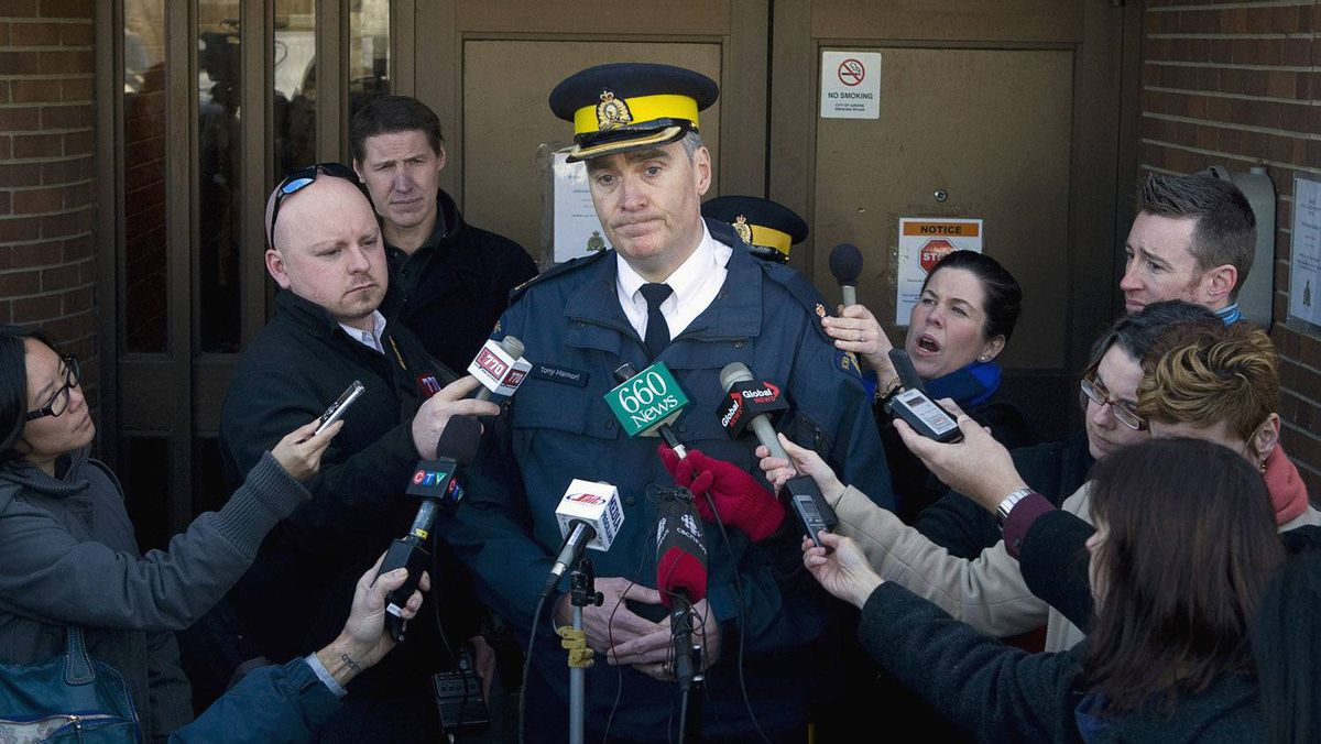 RCMP officer Tony Hamori speaks to the media about the death of a newborn infant killed by a dog in Airdrie, Alta., on Feb. 16, 2012.