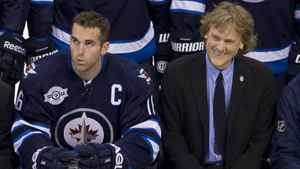 Winnipeg Jets left wing Andrew Ladd (left) and Jets part-owner David Thomson smile as they pose with the rest of the Jets during a team photo prior to a practice in Winnipeg, Saturday, Oct. 8, 2011. The Jets will play the Montreal Canadiens in their inaugural game on Sunday.