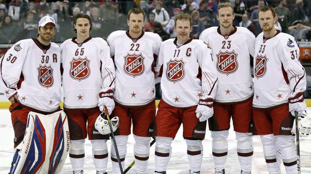 New York Rangers Henrik Lunqvist (30), Ottawa Senators Erik Karlsson (65), Vancouver Canucks Daniel Sedin (22), Ottawa Senators Daniel Alfredsson (11), Vancouver Canucks Alex Elder (23) and Vancouver Canucks Henrik Sedin (33) all of Sweden pose for a photograph after the NHL all-star game in Ottawa.