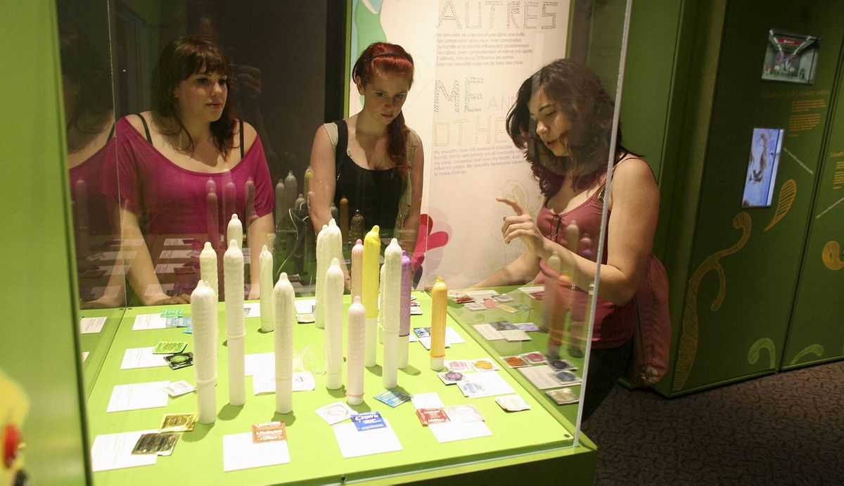 May 23, 2012: Teenagers Danica Brockwell (L-R), Leah Careless and Faith Thomson view a dispaly of condoms at SEX: A Tell-all Exhibition at the Canada Science and Technology Museum in Ottawa. DAVE CHAN for The Globe and Mail