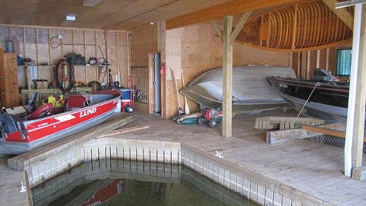 The cottage also features a large two slip boathouse with ample storage space and workshop area.