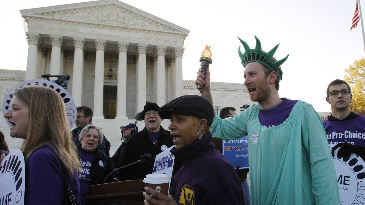 Supporters of U.S. President Barack Obama's health care reform rally outside the Supreme Court in Washington, March 27, 2012, during the second day of legal arguments over the Affordable Care Act.