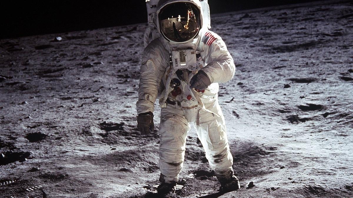 "Astronaut Buzz Aldrin, lunar module pilot, walks on the surface of the Moon near the leg of the Lunar Module (LM) ""Eagle"" during the Apollo 11 exravehicular activity (EVA)."