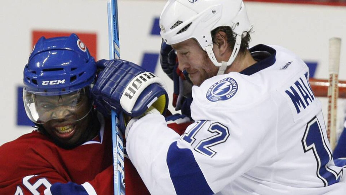 Montreal Canadiens' P.K. Subban takes a hit from Tampa Bay Lightning's Ryan Malone during second period NHL pre-season action Saturday.