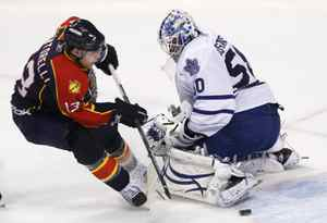 Florida Panthers center Mike Santorelli attempts a shot at Toronto Maple Leafs goalie Jonas Gustavsson during the second period of an NHL hockey game Wednesday, Nov. 10, 2010, in Sunrise, Fla.