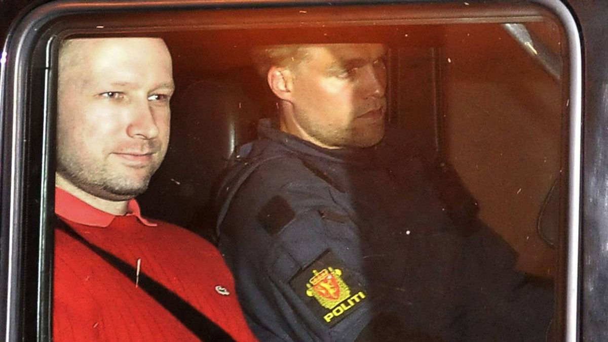 Norwegian Anders Behring Breivik (L), the man accused of a killing spree and bomb attack in Norway, sits in the rear of a vehicle as he is transported in a police convoy as he is leaving the courthouse in Oslo in this July 25, 2011 file photo.