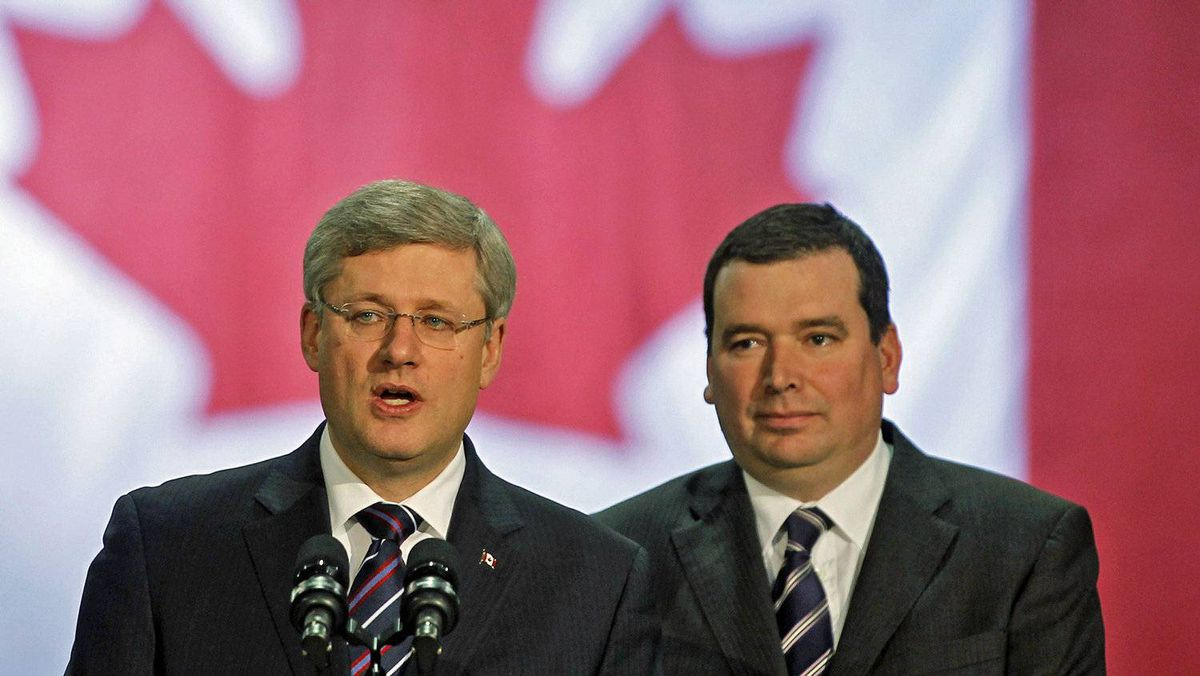 Prime Minister Stephen Harper and local MP Christian Paradis speak to workers at a plant in Thetford Mines, Que. on Dec. 13, 2010.