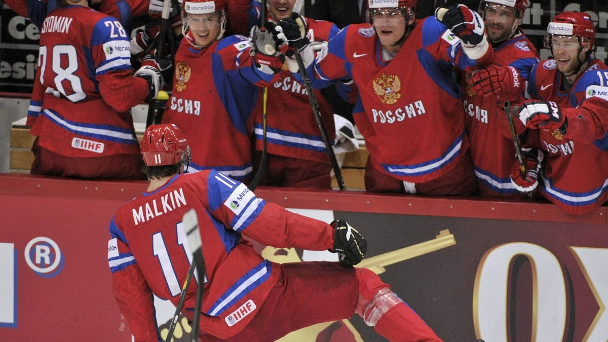 Russia's Yevgeni Malkin celebrates his third goal during the semi-final match Russia vs Finland of the 2012 IIHF World Championships in Helsinki, Finland, on Saturday May 19, 2012.
