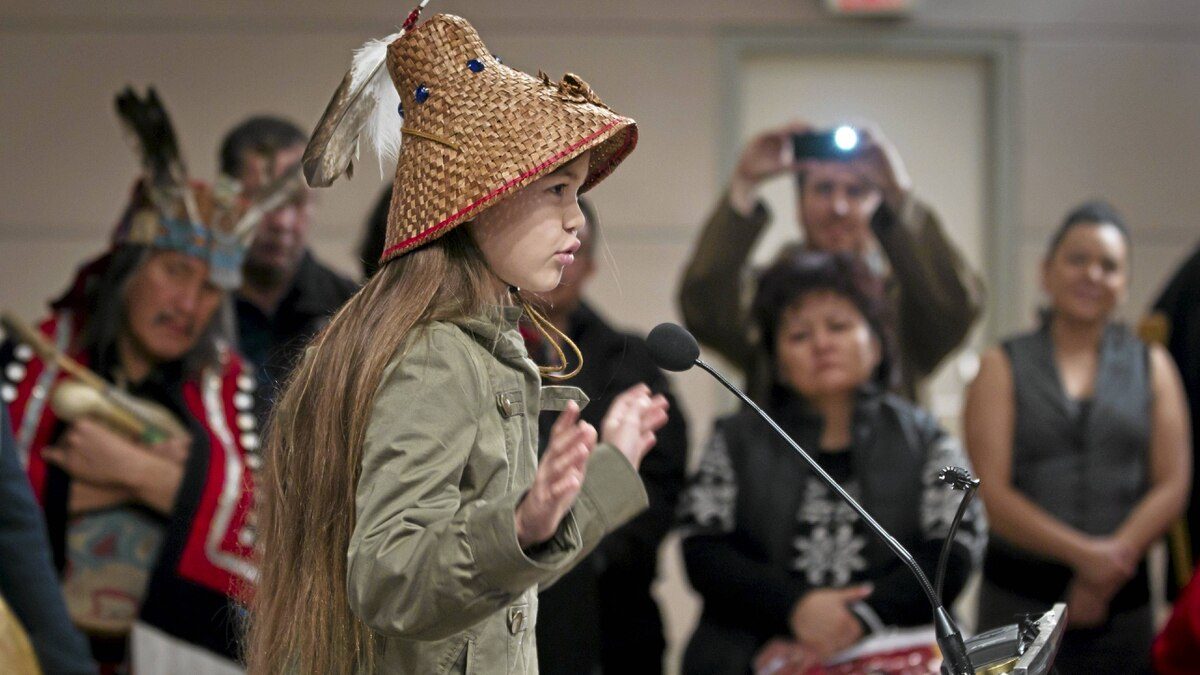 Ta' Kaiya Blaney, 10, speaks Thursday during a signing ceremony with other first nations members in Vancouver after an announcement on the proposed Enbridge Northern Gateway pipeline.