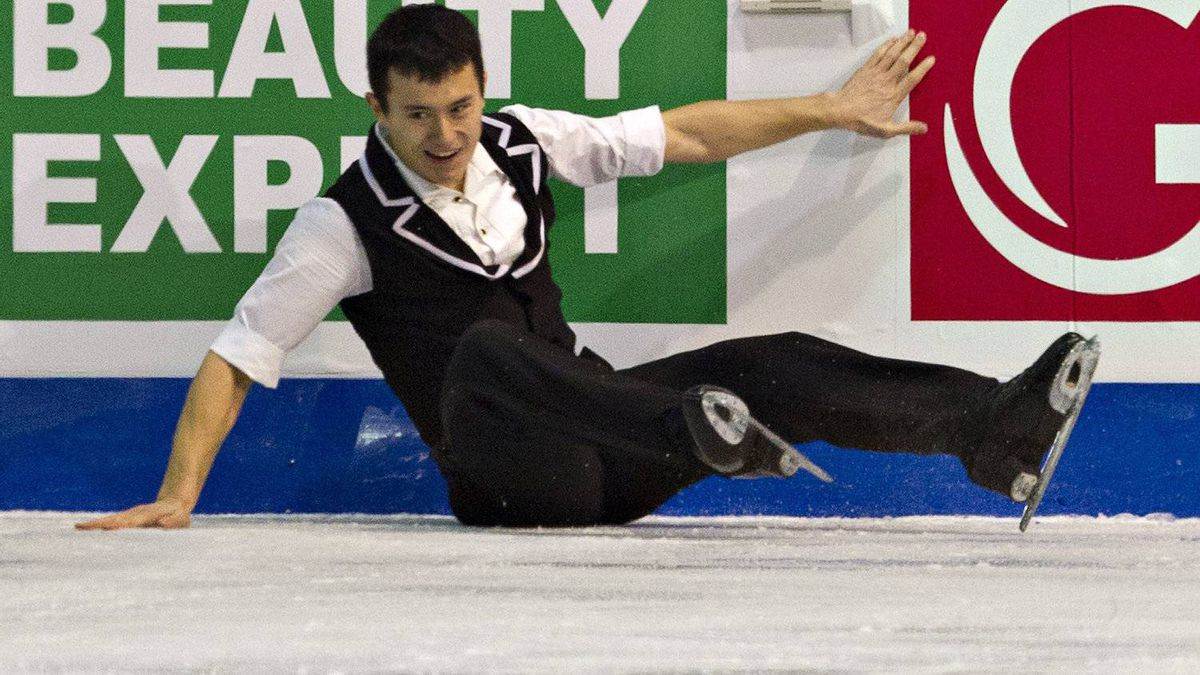 Patrick Chan, of Canada, falls as he performs his short program in the men's competition at the ISU Grand Prix of Figure Skating Final Friday, December 9, 2011 in Quebec City. THE CANADIAN PRESS/Jacques Boissinot