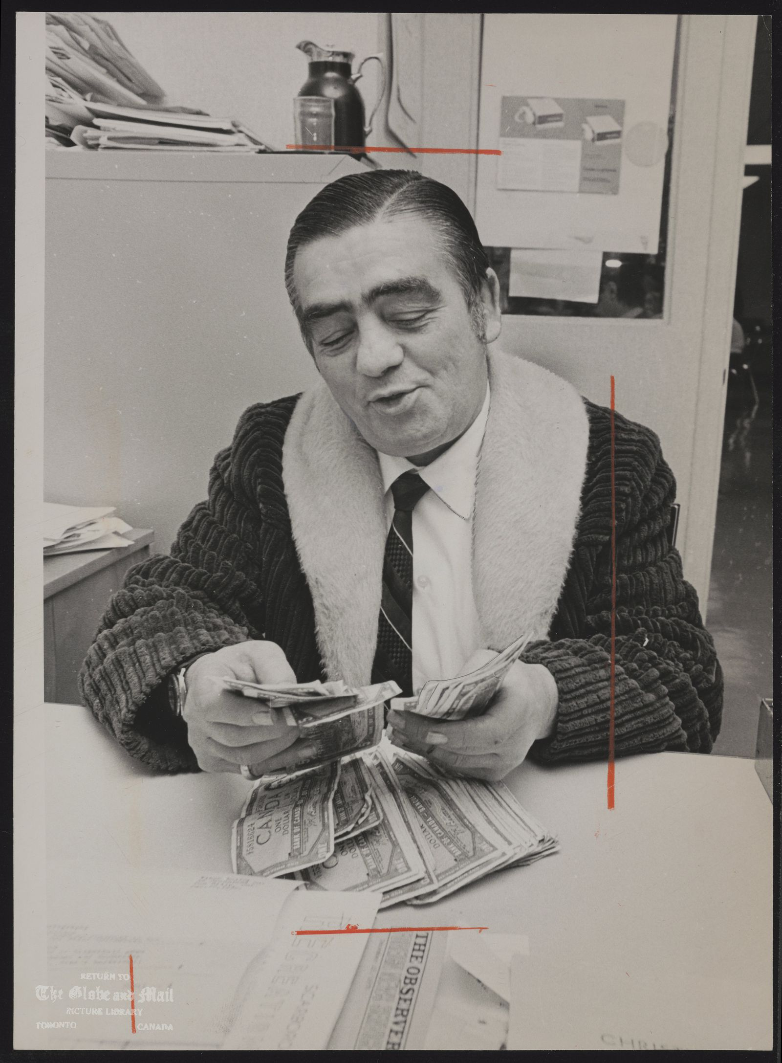 Norman (Baby) YACK Toronto. Former boxer, shown with money he raised for Viponds Christmas fund