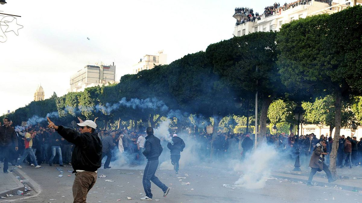 Tunisians demonstrators clash with security forces in Tunis on Jan. 14, 2011, after Tunisian President Zine El Abidine Ben Ali's address to the nation. Police fired massive volleys of tear gas and deployed troops in Tunisia today to disperse thousands of demonstrators calling for the president to step down.
