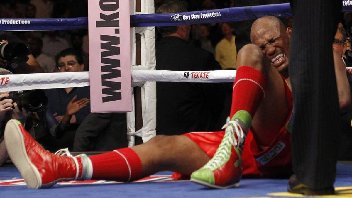 Bernard Hopkins complains of a shoulder injury as Chad Dawson wins by total knockout in the second round during their WBC light heavyweight title bout in Los Angeles.