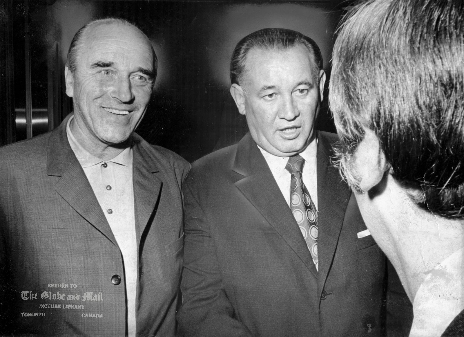AUGUST 16, 1972 -- TORONTO -- RUSSIAN OFFICIALS -- Arkadi Cherneshev, left, and Boris Kulagin, observers from the Russian National hockey team are in Toronto to watch Team Canada practice, August 16, 1972. The first game in the Canada-Russia Summit Series is to be held Sept. 2, 1972 in Montreal. Photo by Harry McLorinan / The Globe and Mail. Originally published August 17, 1972, page A36