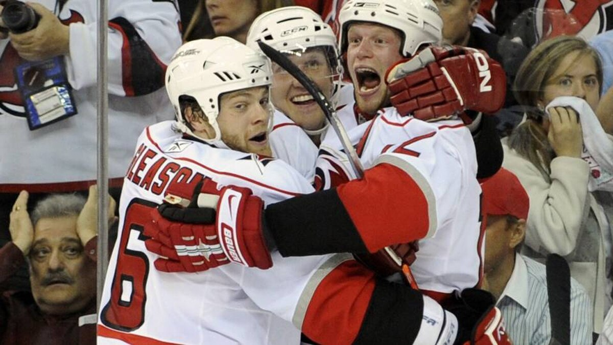 Carolina Hurricanes Eric Staal celebrates with teammates Joni Pitkanen (C) and Tim Gleason (L) after scoring the game-winning goal against the New Jersey Devils in the third period of Game 7 of the NHL Eastern Conference quarterfinals hockey playoffs in Newark, New Jersey April 28, 2009.