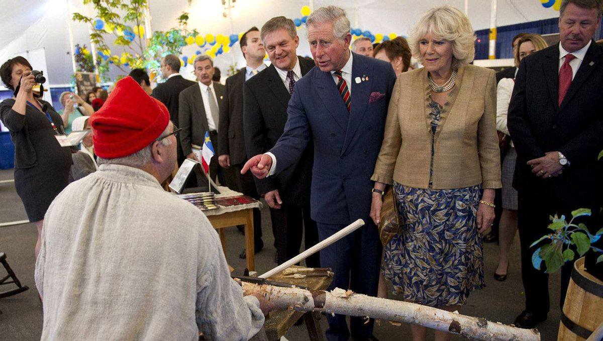 Prince Charles and his wife Camilla chat with a traditional broom maker at a fair in Saint John, N.B., on Monday, May 21, 2012. The royal couple are on a three-day visit to Canada to mark the Queen's Diamond Jubilee.
