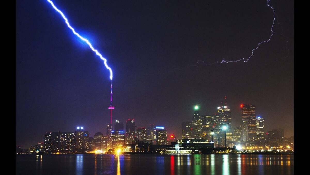 Lightning strikes the CN Tower during a thunderstorm in Toronto May 29, 2011.