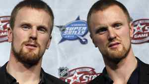 Twin brothers Daniel (L) and Henrik Sedin of the Vancouver Canucks arrive for the team draft for the NHL All-Star hockey game in Raleigh, January 28, 2011. The All-Star game will be played on Sunday. REUTERS/Shaun Best
