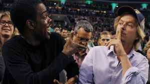 Actors Chris Rock (L) and David Spade joke during the second half of Game 5 of the NBA Eastern Conference playoff series between the Philadelphia 76ers and the Boston Celtics in Boston, Massachusetts May 21, 2012. REUTERS/Brian Snyder