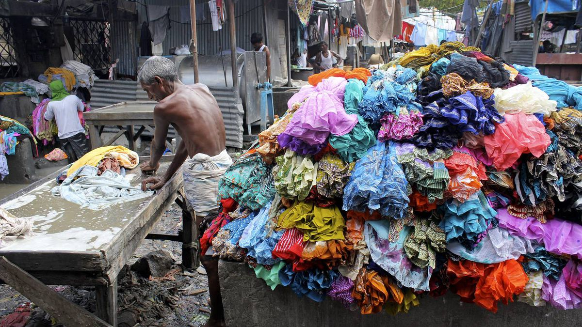 A dhobi (laundryman) is seen working at Dhobi Ghat, an open-air laundry in Bombay. At any given time of the day, some 8,000 to 10,000 dhobis can be seen working from the original stalls that date back to British rule.