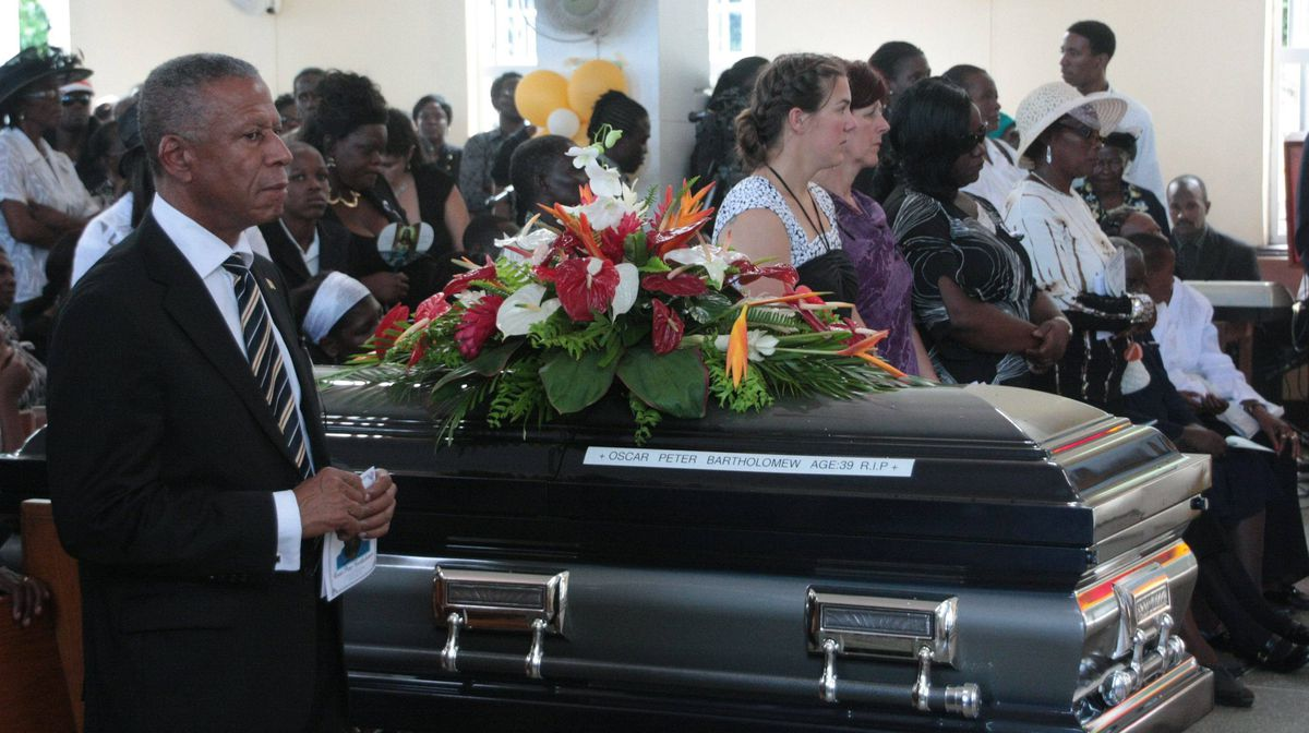 The coffin of Oscar Bartholomew is shown at his funeral service in Crochu, Grenada, Monday, Jan.9, 2012. THE CANADIAN PRESS/Colin Perkel